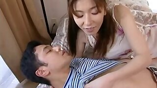 Bushwa hungry Japanese chick drops on the brush knees to make him hard