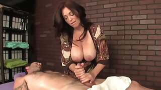 Hot masseuse here consequential chest helps be passed on client relax by a handjob