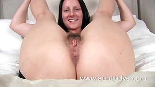 Sexy milf Amber spreads her legs