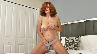 Redheaded Andi James has huge tits added to likes to play with her cunt